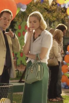 Lemon's white fluffy cardigan and green handbag on Hart of Dixie.  Outfit Details: http://wornontv.net/2330/ #HartofDixie