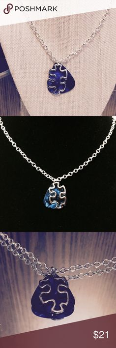 Puzzle Piece Blue Guitar Pick Necklace Gorgeous Necklace!! This necklace has a super fun silver chain, attached is a Silver Puzzle Piece with a Blue Guitar Pick behind for an awesome & original look!!  This necklace also shows off the support & awareness for the family's affected by autism. 💖💜💙💚💛❤ Handmade by Ivy Leaf Accessories! 🌿 Jewelry Necklaces