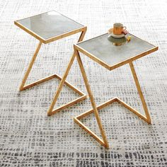Mansfield End Table | Glamour meets minimalism in the Mansfield Side Table. The clean z-shaped silhouette is gilded with antiqued gold leaf and finished with a distressed mirror top. The beautiful proportions make this versatile table an effortlessly chic update to any living room.