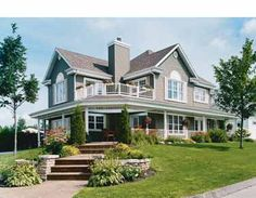 love this country house plan with porches on two levels... great outdoor living!
