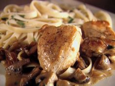 Chicken with Mustard Mascarpone Marsala Sauce 1 1/2 pounds boneless skinless chicken breasts 2 tablespoons olive oil 5 tablespoons butter 3/4 cup onion 1 pound cremini mushrooms 2 tablespoons garlic 1 cup dry Marsala wine 1 cup (8 ounces) mascarpone cheese 2 tablespoons Dijon mustard 2 tablespoons fresh Italian parsley leaves 12 ounces dried fettuccine