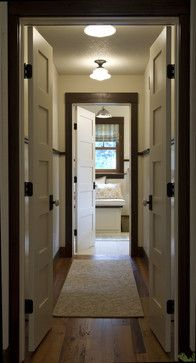 dark wood trim | white painted doors | dark hardware