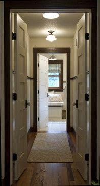 dark wood trim | white painted doors | dark hardware
