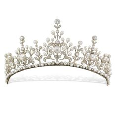 A late Victorian natural pearl and diamond tiara, the tiara comprising five principle sections graduated to the centre, of an ornate openwork scroll and floral design, with a floral drop between each, set throughout with natural pearls and rose-cut and old-cut diamonds, all from a necklet of alternately-set pearls and diamonds, the diamonds estimated to weigh a total of 12.30 carats, all set in silver to a yellow gold mount, with pearl-set snap clasp and safety catch, gross weight 59 grams…