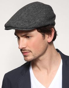 Flat cap: This type of headwear first became fashionable in the last decades of the 19th c. Associated with working class men, it soon was adapted as fashionable boy's wear until stylish young men discovered the cap in the 1920s.