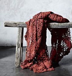 ♥beautiful shot, the contrast of the old wood and the soft crocheted yarn