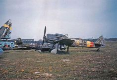A Focke-Wulf Fw-190-A9 fighter that survived the war sits intact and parked amidst other wrecked aircraft at the Salzwedel Luftwaffe base west of the Elbe River (1945).