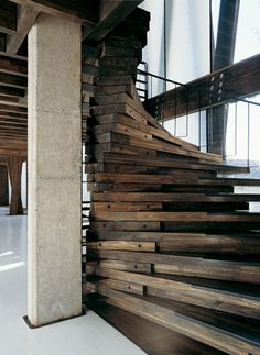 love the pivoting of the stair...it creates such a grand gesture