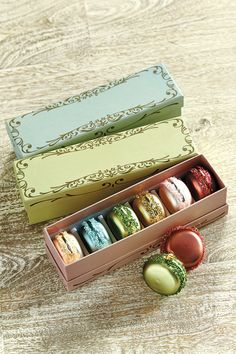 Who could resist these perfect, French macarons? Each box comes with 6 sugary, sweet macaron ornaments and it's own gorgeous gift box. No wrapping required!
