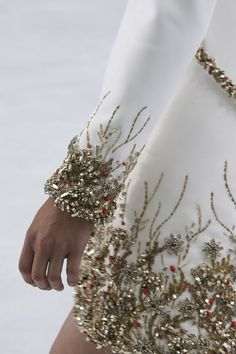 Gold and red beads on white..Chanel fall 2014