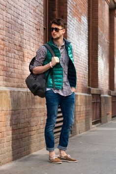 Consider pairing a green gilet with navy blue jeans for a casual level of dress. Complement this look with tan suede boat shoes.