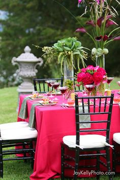 pink table cloths, green tall standingf flowers, candels ect