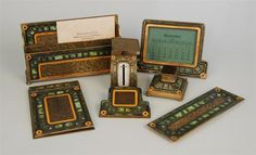 Tiffany Studios desk set in the green Art Deco pattern. (The Art Deco pattern also comes in red, blue, and cream color). This green set was desirable, especially because it included rare pieces, like a scale.