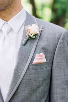 Blush pink boutonniere and pocket square for the groomsmen - so lovely