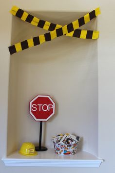 ***put a stop sign on a stand on the table where they stop to get their favors!***
