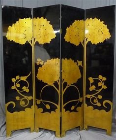 A four-panel screen with gold bamboo decoration