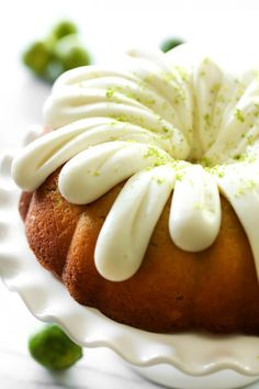 This Key Lime Pie Bundt Cake has such a light, zesty and refreshing flavor! It is super moist and the cream cheese frosting on top is the perfect finishing touch! I substituted 2 sticks of butter and 3 tablespoons of oil for the cup of oil. Food Cakes, Cupcake Cakes, Just Desserts, Delicious Desserts, Dessert Recipes, Key Lime Desserts, Fancy Desserts, Lemon Desserts, Baking Recipes