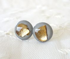 Hey, I found this really awesome Etsy listing at https://www.etsy.com/listing/94482977/grey-and-gold-leaf-stud-earrings-grey