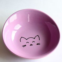 A sweet cat face a day keeps the doc away ;-). This is a small bowl for your cats food. You could use it also for yourself etc.    Let me know