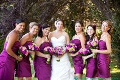 Bride & bridesmaids with their purple, magenta & lime green bouquets.