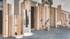 Benedetta Tagliabue encases pillars of 15th-century auditorium in Milan with playful wooden furniture