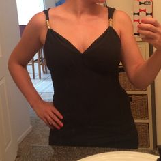 Tank top Size S express tank top in black with gold details on both straps. Super cute for a night out! Express Tops Tank Tops