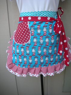 Aprons - Dr. Seuss Apron - Womens Half Apron - The Cat in the Hat Apron - Dr. Seuss - 1957 - Teachers Gift - Robert Kaufman Fabric. $28.95, via Etsy.