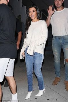 Kourtney Kardashian wearing Designer Remix Sydni Tie Sweater in Cream, Celine White Pointed Mules and Re/done Relaxed Two Tone Crop Jeans