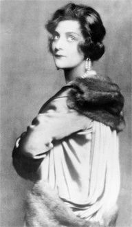 Coco Chanel...''We couldn't have a gallery devoted to 1920s style without including Coco. She revolutionized women's fashion during the Jazz Age, introducing loose, jersey fabrics, long strings of pearls, and a feminine take on sailor suits.  Signature look: Pearls, a drop-waisted LBD and a wavy hairstyle.''
