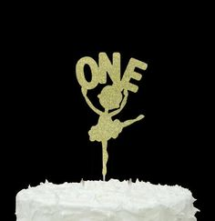 Dancing Ballerina holding Number One - First Birthday Ballet Cake Topp – LissieLou. https://lissielou.com/collections/ballerina/products/dancing-ballerina-holding-number-one-first-birthday-ballet-cake-topper-large-glitter-silver-1