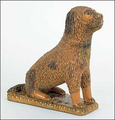 Large Pennsylvania redware dog, 19th c.,
