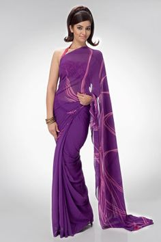 An evening wear saree with a tonal body and bold linear lines on the palla. The interesting combination of the violet and magenta adds life to this simple saree, comes with a matching unstitched blouse.