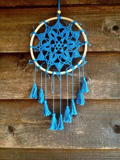 *Borlas de Agua* Mandala Crochet Dreamcatcher Handmade crochet mandala Dreamcatcher. Agua means water in spanish and this mandala was made with the inspiration of the breeze of water and wind. Sea water, river water. Color-Blue Material-Yarn, bamboo ring. Size- 20cm diameter, 37cm