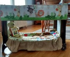 Repurposed our pack n play that was not being used anymore. I cut out both mesh sides.. Others have cut out only 1 side..but I like the openness of both sides. Crib sheet secured on top. Bumper pads around upper part and matching quilt inside. Finished off with a dust ruffle I had. I love how it turned out. Cute little fort/reading nook.