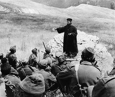 A priest gives a sermon to a group of Greek soldiers before they head into battle.   Location: Border of Greece and Albania. Pin by Paolo Marzioli
