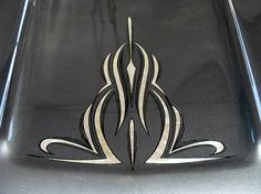 Pinstriping on a black hood.