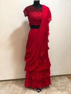 Stylist partywear ruffle saree with net embroidered blouse - Fabric : Pure Georgette with four side Ruffle laceBlouse : Pure net with embroidery Work Drape Sarees, Saree Draping Styles, Saree Styles, Fancy Sarees, Party Wear Sarees, Indian Dresses, Indian Outfits, Indische Sarees, Pure Georgette Sarees