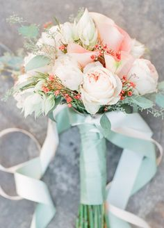 This beautiful peach roses bouquet is wrapped with mint green ribbons.