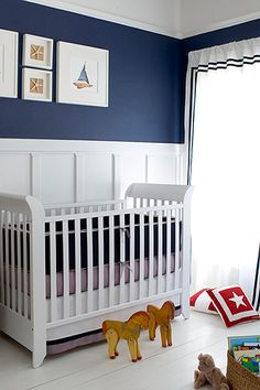 Nautical nursery ... love the wainscoting with navy blue :)!