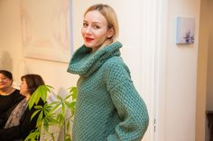 Emerald green knitted sweater. The neckband can be also worn as a hat
