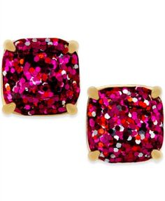 A pair of glistening beauties from kate spade new york, these stud earrings flaunt rich red for a sparkling pop of style. Crafted in gold-tone mixed metal. Approximate diameter: 1/2 inch.   Photo may