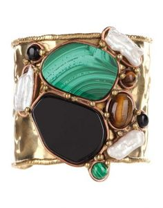 From St Xavier Maya Cuff - Gold-tone cuff. The From St Xavier Maya Cuff is made from a textured, gold-tone composition with contrast-textured trim and a gorgeous display of tiger eye, black onyx, malachite and biwa bead stone embellishments elegantly trimmed in an antique-style copper and gold-tone detailing. Measurements: Diameter: 21cm. $69.95