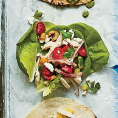 Greek Chicken Tacos | Crisp lettuce cups offer a light, refreshing spin to this Greek salad-inspired taco, but feel free to use warm flour tortillas or pitas instead.