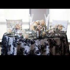 Love the black lace over the white tablecloth