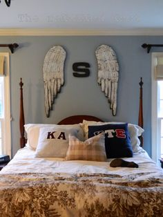 These wings made of wood with tin feathers at the top of the bed have a feel of the ancient guardians of man... Angels!