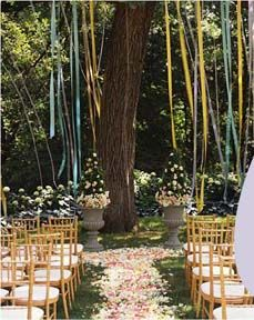 Hanging things in trees creates a romantic and ethereal feel that you just can't beat. Hang lights in the trees, hang ribbons or origami from the trees, hang lanterns in the trees....trust me, it's buttuh.