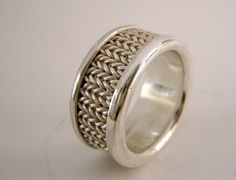 Woven fine silver wire set in a sterling silver ring.  Its width is 10 mm  Size us 71\/2 = no 16