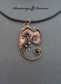handmade: necklaces , pendants technique: wire-wrapping materials: copper etching, size: 6*4 cm