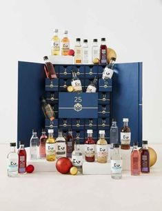 Marks & Spencer drinks advent calendar perfect for the festive season. This packaging is a blue box that has two doors revealing twenty-five small cardboard drawers that holds the small bottles of alcohol drinks.  Designed by Marks & Spencer