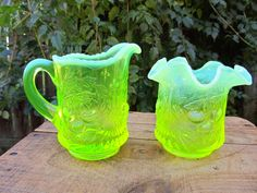 This listing is for the coolest creamer and Sugar bowl ever!! These glass pieces were made by Fenton and are referred to as Vaseline glass in Topaz